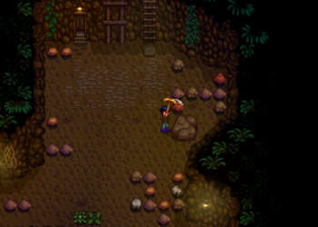 A farmer uses his pickaxe on a boulder in the mines of Stardew Valley